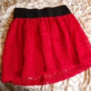 Red, rose design, NWOT mini skirt.